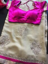 Golden Georgette Saree with Magenta Blouse