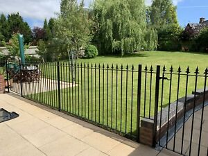 wraught iron fence And Two Gates