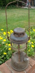 VINTAGE TILLEY STORM LAMP/LANTERN WITH GLASS BOWL AND BRASS BASE PARAFFIN.
