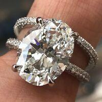 6.13 Carat Oval Diamond H VS2 GIA Certified, Set in platinum and diamond