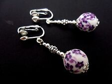 A PAIR OF SILVER PLATED PORCELAIN FLOWER  BEAD DANGLY EARRINGS NEW.