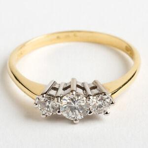 Round Cut Brilliant Diamond Trilogy Ring, 18K Yellow Gold.