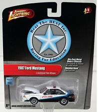 Johnny Lightning 1987 Ford Mustang Beat The Heat #53505E New NRFP Wht/Blk 1:64