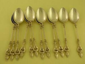 12 gold washed Spoons by CHRISTOFLE ornamental handles - hallmarked ~no mono