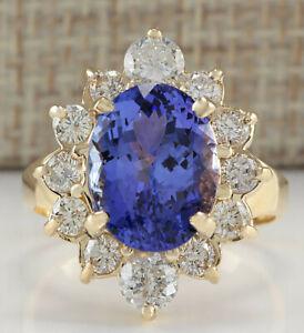 6.46 Carat Natural Tanzanite 14K Yellow Gold Diamond Ring