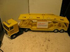 Ertl yellow Chevrolet Heart of america die cast car carrier truck