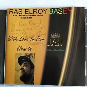 RAS ELROY BASEY WITH LOVE IN OUR HEARTS CD ALBUM  SIGNED ON COVER BLACK SLATE