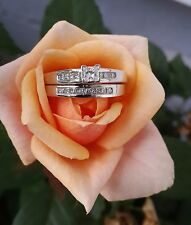 14 kt. White Gold bridal set with a princess cut center diamond engagement ring