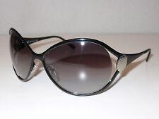 cb86fb24a1 Occhiali da sole da donna con lenti in grigio con montatura in nero ...