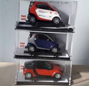 BUSCH H0  - Selection of 3 Smart cars.