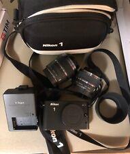 Nikon J1 fotocamera con accessori/obiettivi