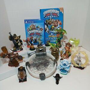Lot 14 Skylanders Figures, Game, Official Book & Portal Team Trap PS4 Activison
