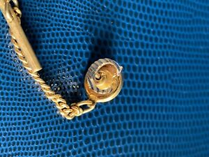 """Sterling silver tie tack. Letter """"C"""". Initial has machined groves."""