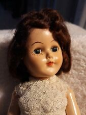 "Hard Plastic Doll with Eyes that Open and Close 10"" in blue dress with lace"