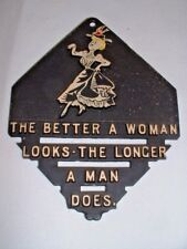 """Vintage Wall Hanging Black Metal Trivet """"The Better A Woman Looks...""""  Quote"""