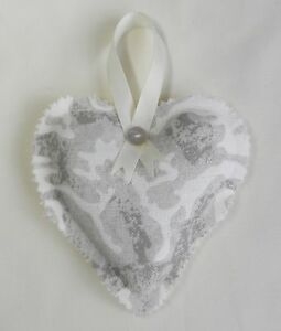 Handmade decorative, padded heart. Ivory linen look cotton with a taupe pattern.