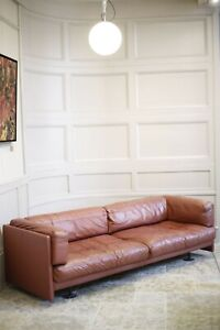 Large mid 20th century red leather sofa