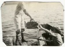 1930s Mystery Valise Handed Off from Dock to Rowboat Snapshot