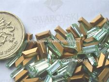 18 x Swarovski 7mm x 3mm Chrysolite gold-foiled #4501 baguettes