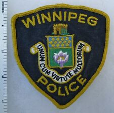 WINNIPEG CANADA POLICE - Used ORIGINAL Vintage SHOULDER PATCH ( YELLOW LETTERS )
