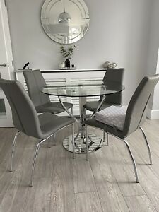Next Tulip Glass Dining Table And 4 Grey Faux Leather Dining Chairs
