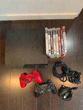 SONY PLAYSTATION 3 CONSOLE, 2 CONTROLLERS AND 8 GAMES!!!MODEL # CECH-3001A