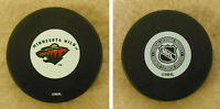 LOT OF 2 HOCKEY PUCKS - NHL OFFICIAL IN GLAS CO - MINNESOTA WILD   - FREE SHIP
