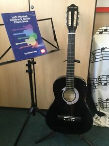 Stretton Payne 3/4 LEFT HANDED acoustic guitar, chord book and guitar stand.