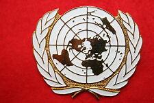 GENUINE METAL BERET BADGE UN UNITED NATIONS EASTERN SLAVONIA UNTAES