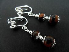 A PAIR OF BROWN/BLACK GOLDSTONE BEAD  AND SILVER  PLATED CLIP ON EARRINGS.