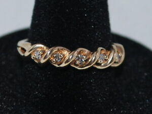 10k Yellow Gold Ring With 5 Natural Diamonds Set In A Beautiful Band Design