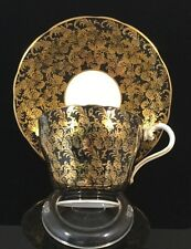 """Aynsley """"C869"""" Gold Floral On Black Cup and Saucer Set"""