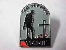 11.11.11 & Soldier at grave lest we forget pin badge