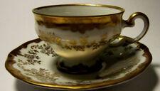 Weimar Porzellan Moccatasse und Untertasse mit reichlich Goldstaffage