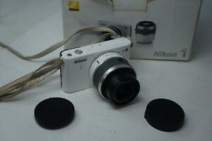 Nikon J1 10.1MP, Interchangeable Lens (Pop Up Flash) with 10-30mm AF lens