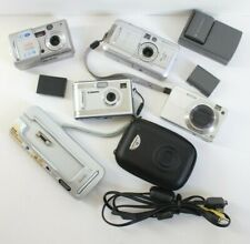 Lot of 4 Cameras, Charger & Batteries for Parts- Canon, Olympus, Sony. Kodak +