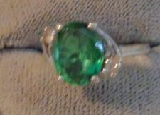 DECO BEAUTIFUL  RING IN 10KT WG  W. CLEAR green stone  EMERALD??