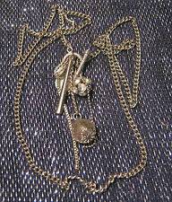 Silver tone necklace with a very nice mish-mash of pendants and charms
