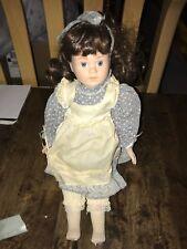 Porcelain Brown Hair Girl Sitting Doll