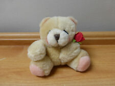 FOREVER FRIENDS BEAR HOLDING A RED ROSE