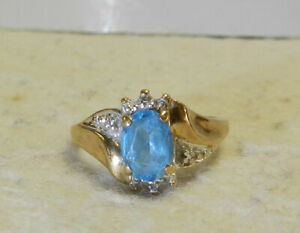 #J30 Light Blue Stone 10k Gold Ring Size 4 Secondary Diamonds Total Weight 2.2 G