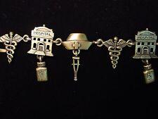 """JJ"" Jonette Jewelry Bronze Pewter NURSE Symbols 7 1/4"" Bracelet"