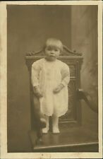 Young Girl Standing On Chair    Ri.500