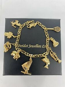 18ct Yellow Gold Charm Bracelet With 9 x Assorted Charms