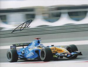Fernando Alonso signed photo. Renault 2006.  COA. 15X21