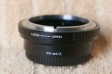 Camera lens adapter Canon FD-3/4.Never used before.