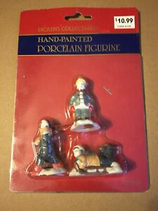 VINTAGE CHRISTMAS DICKENS COLLECTABLES ICE SKATERS PORCELAIN FIG. NOS SEALED!