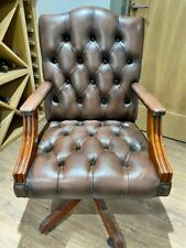 Gainsborough Reproduction Brown swivel Leather Chair, with Mahogany wooden finis