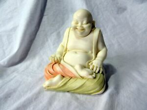 A VINTAGE LAUGHING BUDDHA FIGURE
