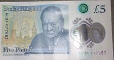 brand new £5 note with serial number AB34